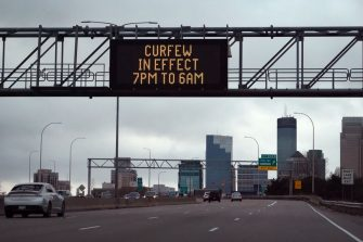 MINNEAPOLIS, MINNESOTA - APRIL 12: A sign above the interstate warns residents and visitors of a curfew put in place in an attempt to curtail violence on April 12, 2021 in Minneapolis, Minnesota. People have taken to the streets to protest after Daunte Wright, a 20-year-old Black man, was shot and killed by Brooklyn Center police officer Kimberly Potter during a traffic stop yesterday. (Photo by Scott Olson/Getty Images)