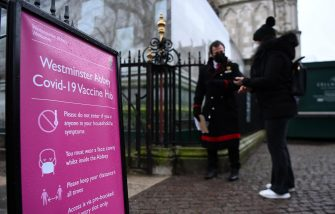 epa09065496 A Covid-19 vaccination centre sign outside Westminster Abbey in London, Britain, 10 March 2021. Westminster Abbey has opened its doors acting as a vaccination centre in London. More than twenty million people have already received their first dose of a Covid-19 vaccine in the UK.  EPA/ANDY RAIN