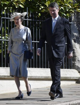 epa07519280 Britain's Princess Anne (L) and her husband Timothy Laurence (R) arrive for the annual Easter Sunday Service at St Georges Chapel in  Windsor Castle, Britain, 21 April 2019. The Easter Mattins Service is attended every year by the Royal Family. This year the service falls on the Queen's Elizabeth II birthday.  EPA/NEIL HALL
