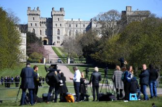 epa09140925 Media gather outside Windsor Castle in Windsor, Britain, 17 April 2021. Britain's Prince Philip, the Duke of Edinburgh, died on 09 April 2021 aged 99, his funeral is to take place on 17 April during a closed ceremony in Windsor Castle.  EPA/NEIL HALL