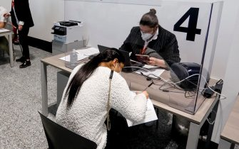 Passengers arriving from the United States on Covid Tested flights pass the first checks at Malpensa Airport in Ferno, Italy, 03 April 2021. ANSA / Mourad Balti TouatiANSA/Mourad Balti Touati