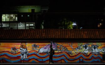 epa08938219 A man waits at a bus stop in Manaus, State of Amazonas, Brazil, 14 January 2021. Manaus, the largest city in the Brazilian Amazon, enforced an 11-hour curfew between 7:00 p.m. and 6:00 a.m. after hospitals and cemeteries ran out of capacity amid a spike in Covid-19 cases.  EPA/Raphael Alves