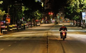 NAIROBI, KENYA - 2021/03/29: A motorcyclist riding along a deserted Moi Avenue in Nairobi as the new 8pm-4am curfew takes effects.On Friday, March 26th, President Uhuru Kenyatta announced a  partial lockdown and instituted new curfew measures to start from 8pm to 4am. The new measures to curb the spread of COVID-19 include placing Nairobi, Nakuru, Kiambu and Machakos counties under partial lockdown as well as closing restaurants, bars and schools nationwide amid a third wave of COVID-19 across the country. (Photo by Boniface Muthoni/SOPA Images/LightRocket via Getty Images)