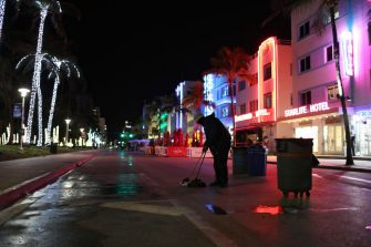 MIAMI BEACH, FLORIDA - MARCH 21: A City employee cleans up on Ocean Drive after people left due to an 8pm curfew on March 21, 2021 in Miami Beach, Florida. College students have arrived in the South Florida area for the annual spring break ritual, prompting city officials to impose an 8pm to 6am curfew as the coronavirus pandemic continues. Miami Beach police have reported hundreds of arrests and stepped up deployment to control the growing spring break crowds. (Photo by Joe Raedle/Getty Images)