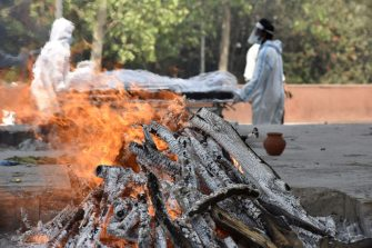 NOIDA, INDIA - APRIL 22: A funeral pyre of a Covid-19 victim, at a crematorium, in Sector 94, on April 22, 2021 in Noida, India. (Photo by Sunil Ghosh/Hindustan Times via Getty Images)