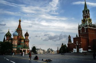 (FILES) In this file photo taken on May 30, 2020 people walk on Red Square in downtown Moscow. - Moscow Mayor Sergei Sobyanin announced on June 8 the end of a strict anti-coronavirus lockdown in place for weeks in the Russian capital. (Photo by Dimitar DILKOFF / AFP)