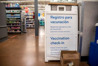 SAN ANTONIO, TX - MARCH 29: A vaccine check in area inside a Wal-Mart on March 29, 2021 in San Antonio, Texas. Texas has opened up all vaccination eligibility to all adults starting today. Texas has had a slower roll out than some states and with the increase in eligibility leaders are hoping more and more citizens get vaccinated. (Photo by Sergio Flores/Getty Images)