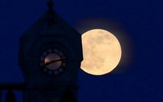 The Super Pink Full Moon rises over the former Almonte post office, which is a National Historic Site of Canada, in Mississippi Mill, Ont., on Monday, April 26, 2021. The April full moon is called the Pink Moon because it coincides with the spring blooming of the herb moss pink wildflower. THE CANADIAN PRESS/Sean Kilpatrick