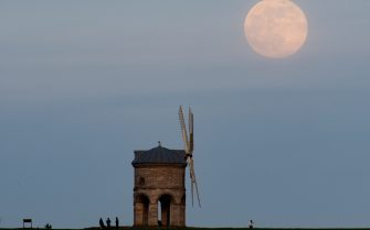 The moon rises behind Chesterton Windmill in Warwickshire, before the April super full moon on the 27th, which is traditionally known as the Pink Moon. Picture date: Monday April 26, 2021.