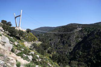 epa09164740 A view of '516 Arouca', considered the largest pedestrian suspension bridge in the world, at 516 meters long and 175 meters high, in Arouca, Portugal, 16 April 2021 (issued 28 April 2021). The bridge is secured by steel cables arranged 175 meters above the Paiva riverbed and can be visited by the general public from 03 May.  EPA/ESTELA SILVA