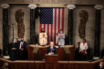 epa09166272 U.S. President Joe Biden addresses a joint session of congress as Vice President Kamala Harris (L) and Speaker of the House U.S. Rep. Nancy Pelosi (D-CA) (R) look on in the House chamber of the U.S. Capitol in Washington, DC, USA, 28 April 2021.  EPA/Chip Somodevilla / POOL