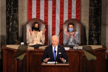epa09166266 U.S. President Joe Biden addresses a joint session of congress as Vice President Kamala Harris (L) and Speaker of the House U.S. Rep. Nancy Pelosi (D-CA) (R) look on in the House chamber of the U.S. Capitol in Washington, DC, USA, 28 April 2021.  EPA/Chip Somodevilla / POOL