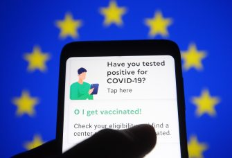 In this photo illustration a TousAntiCovid app is seen on a smartphone with the EU flag in the background. France will reportedly be the first European Union member state to introduce the COVID-19 travel pass, the first example of a Digital Green Certificate that is slated to be rolled out across the EU by mid-June, reportedly by media. The TousAntiCovid app has already been downloaded by about 15 million people. It will display PCR tests and antigen tests. It will also include vaccination certificates. The COVID passports will be available as a mobile app or in paper form. - Pavlo Gonchar / SOPA Images//SOPAIMAGES_PGONCHAR_W8741/2104211302/Credit:SOPA Images/SIPA/2104211305