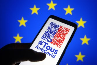 In this photo illustration a TousAntiCovid app is seen on a smartphone with the EU flag in the background. France will reportedly be the first European Union member state to introduce the COVID-19 travel pass, the first example of a Digital Green Certificate that is slated to be rolled out across the EU by mid-June, reportedly by media. The TousAntiCovid app has already been downloaded by about 15 million people. It will display PCR tests and antigen tests. It will also include vaccination certificates. The COVID passports will be available as a mobile app or in paper form. - Pavlo Gonchar / SOPA Images//SOPAIMAGES_PGONCHAR_W8225/2104211302/Credit:SOPA Images/SIPA/2104211305