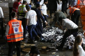 epa09168830 Israeli security officials and rescuers inspect the dead bodies of dozens of Ultra-Orthodox Jews who died during an event at a revelry complex during Lag Ba'Omer; in Mount Meron, Israel, 29 April 2021. Dozens of people were killed and injured in the revelry complex on Mount Meron, after an apparent stampede occured during an event marking the end of the Jewish holiday of Lag Ba'Omer, the day marks the anniversary of the death of Rabbi Shimon bar Yochai, a sage from some 1,800 years ago, and the day on which he revealed the secrets of the 'kabbalah,' or Jewish mysticism.  EPA/DAVID COHEN ISRAEL OUT