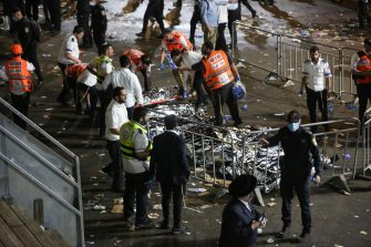 epa09168828 Israeli security officials and rescuers inspect the dead bodies of dozens of Ultra-Orthodox Jews who died during an event at a revelry complex during Lag Ba'Omer; in Mount Meron, Israel, 29 April 2021. Dozens of people were killed and injured in the revelry complex on Mount Meron, after an apparent stampede occured during an event marking the end of the Jewish holiday of Lag Ba'Omer, the day marks the anniversary of the death of Rabbi Shimon bar Yochai, a sage from some 1,800 years ago, and the day on which he revealed the secrets of the 'kabbalah,' or Jewish mysticism.  EPA/DAVID COHEN ISRAEL OUT