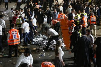 epa09168832 Israeli security officials and rescuers inspect the dead bodies of dozens of Ultra-Orthodox Jews who died during an event at a revelry complex during Lag Ba'Omer; in Mount Meron, Israel, 29 April 2021. Dozens of people were killed and injured in the revelry complex on Mount Meron, after an apparent stampede occured during an event marking the end of the Jewish holiday of Lag Ba'Omer, the day marks the anniversary of the death of Rabbi Shimon bar Yochai, a sage from some 1,800 years ago, and the day on which he revealed the secrets of the 'kabbalah,' or Jewish mysticism.  EPA/DAVID COHEN ISRAEL OUT