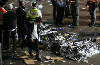 epa09168826 Israeli security officials and rescuers inspect the dead bodies of dozens of Ultra-Orthodox Jews who died during an event at a revelry complex during Lag Ba'Omer; in Mount Meron, Israel, 29 April 2021. Dozens of people were killed and injured in the revelry complex on Mount Meron, after an apparent stampede occured during an event marking the end of the Jewish holiday of Lag Ba'Omer, the day marks the anniversary of the death of Rabbi Shimon bar Yochai, a sage from some 1,800 years ago, and the day on which he revealed the secrets of the 'kabbalah,' or Jewish mysticism.  EPA/DAVID COHEN ISRAEL OUT
