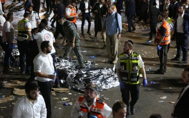 epa09168831 Israeli security officials and rescuers inspect the dead bodies of dozens of Ultra-Orthodox Jews who died during an event at a revelry complex during Lag Ba'Omer; in Mount Meron, Israel, 29 April 2021. Dozens of people were killed and injured in the revelry complex on Mount Meron, after an apparent stampede occured during an event marking the end of the Jewish holiday of Lag Ba'Omer, the day marks the anniversary of the death of Rabbi Shimon bar Yochai, a sage from some 1,800 years ago, and the day on which he revealed the secrets of the 'kabbalah,' or Jewish mysticism.  EPA/DAVID COHEN ISRAEL OUT