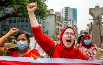 epa09170971 Members of a labor rights organization shout slogans as they take part in a rally marking International Workers' Day, or May Day, amid a COVID-19 lockdown in Dhaka, Bangladesh, 01 May 2021.  EPA/MONIRUL ALAM