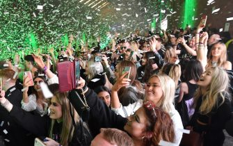 LIVERPOOL, ENGLAND - APRIL 30: Confetti is fired into the crowd as Nightclub Circus hosts the first dance event, which will welcome 6,000 clubbers to the city's Bramley-Moore Dock warehouse on April 30, 2021 in Liverpool, England. The event is part of the national Events Research Programme which will provide data on how events could be permitted to safely reopen. (Photo by Anthony Devlin/Getty Images)