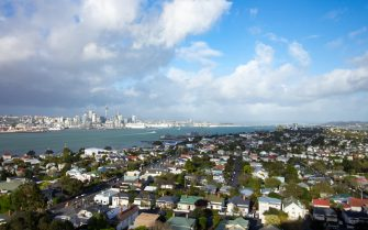 The urban skyline and surrounding neighborhoods of Auckland, New Zealand, as well as Auckland Harbor, are visible from Mount Victoria under a dramatic sky, October 11, 2017. (Photo by Smith Collection/Gado/Getty Images)