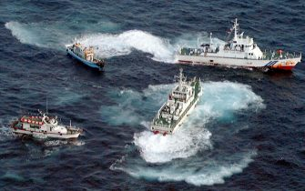Two patrol ships of the Japanese coastal guards attempt to stop Taiwanese fishing boats heading to the disputed Diaoyu-Senkaku island in the East China Sea 26 May. A fishing boat carrying six Taiwanese journalists covering the protest by some 200 ethnic Chinese was sinking after being rammed by Japanese coastguard vessels, said protest organizers.