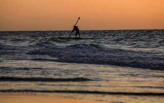 epa09008141 A Palestinian fisherman goes fishing at sea during sunset in Gaza City, 12 February 2021.  EPA/MOHAMMED SABER
