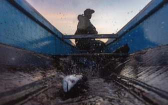 epa07398519 A fish flaps in the hull of a pirogue as it dies whilst Senegalese fisherman Modu Samba fishes in the Atlantic Ocean off the 400 year old fishing village of Ngor, Dakar, Senegal, 26 February 2019. Heavy industrial and large scale fishing practices by international companies has exponentially increased pressure on traditional fishing communities. Highlighted as one of the main causes for the lack of fish for the artisanal fishermen of West Africa is the deals that have been struck over the last 60 years between the governments of West African nations and the countries owning large fishing fleets from Europe and Asia. These deals have benefitted the West African governments financially but not the people they govern. The foreign countries enjoying the fertile fishing grounds off West Africa have been accused of exploiting the resources and ultimately depleting the fishing stocks once the livelihood of the artisanal fisherman. As fish populations decline, stocks move offshore, making them inaccessible to small-scale, artisanal fishermen who do not have vessels or resources to access deep offshore stocks. Each year Modu and the other fishermen of Senegal have to head further and further out to sea using more and more fuel and becoming increasingly more dangerous in their search for fish.  EPA/NIC BOTHMA  ATTENTION: This Image is part of a PHOTO SET