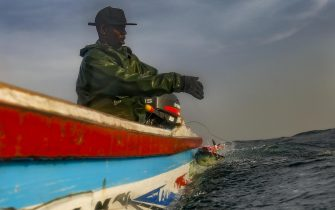 epa07430586 (03/19) Senegalese fisherman Modu Samba catches a fish tens of nautical miles offshore in the Atlantic Ocean off the 400-year-old village of Ngor on the western most tip of Africa, Dakar, Senegal, 26 February 2019. Senegal is choking on plastic waste with tens of thousands of tons of it ending up in the ocean every year. A problem that is not only threatening the coastal population but also the economy. Due to a lack of comprehensive municipal waste management mechanisms, communities have engaged in their own clean ups in some villages. Environmentalists urge a change of policy regarding the use of plastics is urgently needed by government.  EPA/NIC BOTHMA  ATTENTION: For the full PHOTO ESSAY text please see Advisory Notice epa07430583