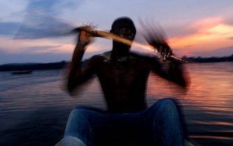 Abdul Monday rowing out to begin a long night fishing in Lake Victoria, the second largest fresh water lake in the world, in Uganda, August 19, 2003. Lake Victoria is the chief source of the Nile river and the ten countries that share in its wealth have formed the Nile Basin Initiative, with sponsorship from the World Bank, to manage the long-term development of this important water-way. The lake is under increasing environmental pressure with the introduction of the exotic Nile perch and a hyacinth invasion.EPA PHOTO/EPA/STEPHEN MORRISON