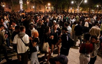 epa09186702 Hundreds of people celebrate in the Passeig Lluis Companys of Barcelona, Spain, 08 May 2021. The state of alarm that was imposed six month ago due to the pandemic expires on 09 May 2021.  EPA/Quique Garcia