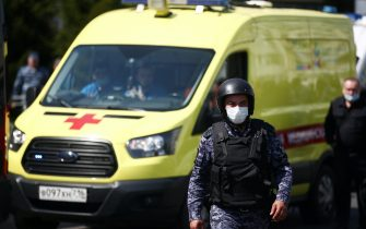 KAZAN, RUSSIA – MAY 11, 2021: An ambulance and a Russian National Guard officer by school No 175 where two attackers opened fire; at least one teacher and eight students are reported dead. Yegor Aleyev/TASS/Sipa USA