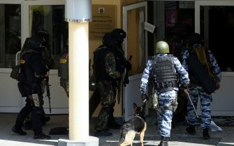 KAZAN, RUSSIA – MAY 11, 2021: FSB and special rapid response unit officers with a service dog by school No 175 where two attackers opened fire; at least one teacher and eight students are reported dead. Yegor Aleyev/TASS/Sipa USA
