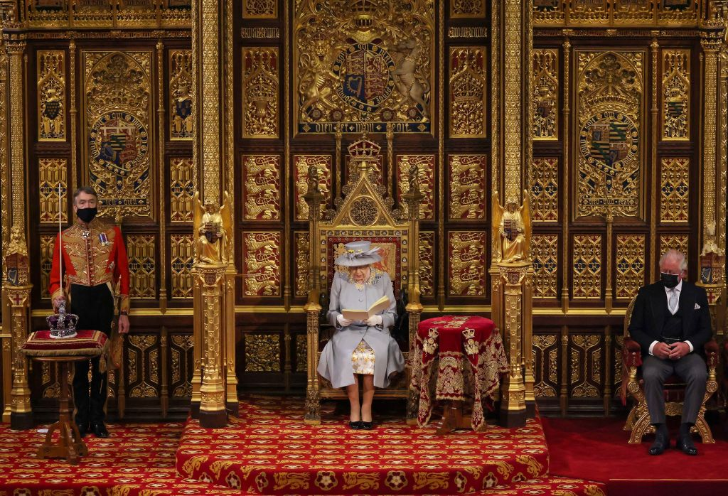 Britain's Queen Elizabeth II reads the Queen's Speech on the The Sovereign's Throne, as Britain's Prince Charles, Prince of Wales (R) listens, in the House of Lords chamber, during the State Opening of Parliament at the Houses of Parliament in London on May 11, 2021, which is taking place with a reduced capacity due to Covid-19 restrictions. - The State Opening of Parliament is where Queen Elizabeth II performs her ceremonial duty of informing parliament about the government's agenda for the coming year in a Queen's Speech. (Photo by Chris Jackson / POOL / AFP) (Photo by CHRIS JACKSON/POOL/AFP via Getty Images)