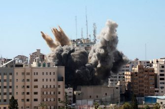 A thick column of smoke rises from the Jala Tower as it is destroyed in an Israeli airstrike in Gaza city controlled by the Palestinian Hamas movement, on May 15, 2021. - Israeli air strikes pounded the Gaza Strip, killing 10 members of an extended family and demolishing a key media building, while Palestinian militants launched rockets in return amid violence in the West Bank. Israel's air force targeted the 13-floor Jala Tower housing Qatar-based Al-Jazeera television and the Associated Press news agency. (Photo by Majdi Fathi/NurPhoto via Getty Images)
