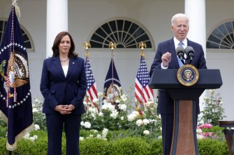 WASHINGTON, DC - MAY 13: U.S. President Joe Biden delivers remarks on the COVID-19 response and vaccination program as Vice President Kamala Harris listens in the Rose Garden of the White House on May 13, 2021 in Washington, DC. The Centers for Disease Control and Prevention (CDC) announced today that fully vaccinated people will no longer need to wear masks or socially distance for indoor and outdoor activities in most settings. (Photo by Alex Wong/Getty Images)