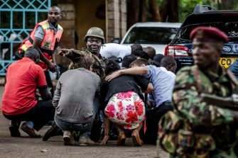Special forces protect people at the scene of an explosion at a hotel complex in Nairobi's Westlands suburb on January 15, 2019, in Kenya. - The Al-Shabaab Islamist group in Somalia claimed responsibility for an ongoing attack in the Kenyan capital, according to the SITE Intelligence Group which monitors jihadist activities. AFP PHOTO / LUIS TATO