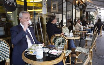 Economy Minister Bruno le Maire makes a coffee stop at 'Comptoir Des Saint Peres' on May 19, 2021 in Paris as France eases Covid-19 lockdown restrictions. Bars, shops and cultural spaces across France reopen as the country starts lifting restrictions aimed at preventing the spread of coronavirus. As of Wednesday, groups of up to six people will be allowed to eat together at outdoor restaurant terraces. France's nationwide curfew is also being pushed back from 19:00 to 21:00. Photo by Eliot Blondet/ABACAPRESS.COM