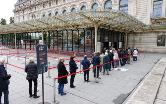 PARIS, FRANCE - MAY 19: Visitors are back at Musee d'Orsay on May 19, 2021 in Paris, France. The country is taking steps to ease the lockdown measures that President Emmanuel Macron announced on April 29, allowing all the museums and non-essential shops and cultural venues to open and rolling back the curfew to 9pm. The cafe and restaurant terraces can also open to 50% capacity. France is reporting a seven-day average of around 14,000 new Covid-19 cases. (Photo by Pierre Suu/Getty Images)