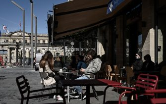 Customers sit at the outdoor terrasse of a cafe restaurant in Bordeaux on May 19, 2021,  as cafes, restaurants and other businesses re-opened after closures during the coronavirus (Covid-19) pandemic. - The French made their way back to cafes and prepared long-awaited visits to cinemas and museums as the country loosened restrictions in a return to semi-normality after over six months of Covid-19 curbs. Cafes and restaurants with terraces or rooftop gardens can now offer outdoor dining, under the second phase of a lockdown-lifting plan that should culminate in a full reopening of the economy on June 30. (Photo by Philippe LOPEZ / AFP) (Photo by PHILIPPE LOPEZ/AFP via Getty Images)