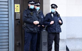 13/03/2021. London, UK.  A heavy police presence outside Westminster Magistrates Court where murder suspect Wayne Couzens is due to appear. Couzens, A serving Met Police officer, has been charged with with the kidnap and murder of Sarah Everard, who disappeared as she walked home in Clapham, south London. The body of Sarah Everard was later discovered woodland in Kent more than a week after she was last spotted on 3 March. Photo credit: Ben Cawthra/Sipa USA **NO UK SALES**