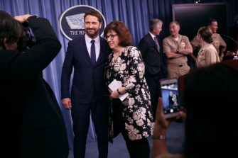 ARLINGTON, VIRGINIA - OCTOBER 15: Scottish Actor Gerard Butler poses for a photograph with CNN Pentagon correspondent Barbara Starr following a news briefing about his new submarine action film 'Hunter Killer' at the Pentagon October 15, 2018 in Arlington, Virginia. Butler spent three days on board a U.S. Navy submarine while researching and preparing to make the film, which stars Butler as an American submarine captain who teams with U.S. Navy Seals to rescue the Russian president, who has been kidnapped by a rogue general. (Photo by Chip Somodevilla/Getty Images)