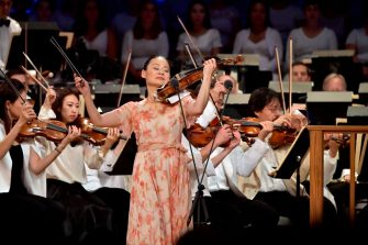 """LENOX, MA - AUGUST 25:  Midori performs Bernstein's Phaedrus at """"The Leonard Bernstein Centennial Celebration at Tanglewood"""" on August 25, 2018 in Lenox, Massachusetts. The Boston Symphony Orchestra was joined by members of the New York Philharmonic, Vienna Philharmonic Orchestra, Israel Philharmonic Orchestra, Tanglewood Music Center Orchestra, Pacific Festival and Schleswig-Holstein Music Festival. The performance was taped by PBS for broadcast in the U.S. on December 28, 2018.  (Photo by Paul Marotta/Getty Images)"""
