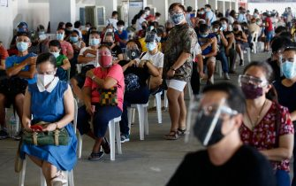 epa09214213 Citizens who received their dose of COVID-19 vaccine stay in a post-vaccination observation area during an inoculation drive in Marikina City, Metro Manila, Philippines, 20 May 2021. The Department of Health is working with local government units to suspend early announcements of vaccine brands available for scheduled vaccination dates and instead inform citizens right before inoculation in order to get consent. The move is aimed at encouraging equal confidence in all available vaccines and avoid overcrowding in inoculation centers caused by brand preference.  EPA/ROLEX DELA PENA