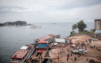 TOPSHOT - This general view of the port of Goma shows residents hurrying towards ferries after an evacuation order has been given on May 27, 2021. - The authorities in Goma, in the east of the Democratic Republic of Congo (DRC), on Thursday morning ordered the evacuation of part of the city because of the risk of eruption of the Nyiragongo volcano, immediately causing the exodus of tens of thousands of people. (Photo by Guerchom NDEBO / AFP) (Photo by GUERCHOM NDEBO/AFP via Getty Images)