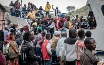 Goma residents are seen boarding a ferry after an evacuation order has been given on May 27, 2021. - The authorities in Goma, in the east of the Democratic Republic of Congo (DRC), on Thursday morning ordered the evacuation of part of the city because of the risk of eruption of the Nyiragongo volcano, immediately causing the exodus of tens of thousands of people. (Photo by Guerchom NDEBO / AFP) (Photo by GUERCHOM NDEBO/AFP via Getty Images)