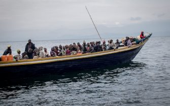 TOPSHOT - Goma residents are seen leaving on a boat on May 27, 2021. - The authorities in Goma, in the east of the Democratic Republic of Congo (DRC), on Thursday morning ordered the evacuation of part of the city because of the risk of eruption of the Nyiragongo volcano, immediately causing the exodus of tens of thousands of people. (Photo by Guerchom NDEBO / AFP) (Photo by GUERCHOM NDEBO/AFP via Getty Images)