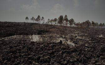 epa09227835 Lava flows at the base of the volcano in Kibati, North of the city of Goma, in the aftermath of a volcanic eruption in North Kivu, Democratic Republic of Congo, 25 May 2021. One of the planets most active volcanoes Mount Nyiragongo in eastern Democratic Republic of Congo erupted 22 May 2021. According to local journalists, aftershocks from the Nyiragongo volcanic eruption continue in the town of Goma. According to the United Nations children's agency (UNICEF) 25 May 2021 more than 100 children are missing after having been separated from their parents. Foreign countries, like the United Kingdom, have warned their nationals through their embassies of the continuation of seismic activity and cannot rule out further fissures or lava flow.  EPA/HUGH KINSELLA CUNNINGHAM