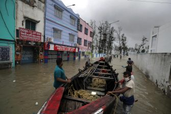epaselect epa09228287 Villagers prepare a boat to rescue people amid a flood as Cyclone Yaas makes landfall in Digha, near the Bay of Bengal, south of Kolkata, India, 26 May 2021. The Odisha and Bengal governments started the evacuation of at-risk areas, as Cyclone Yaas hits the eastern coast of India.  EPA/PIYAL ADHIKARY